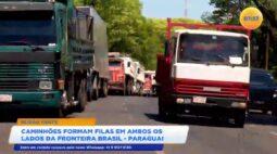 Caminhões formam filas em ambos os lados da fronteira Brasil   Paraguai