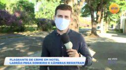 Flagrante de crime em hotel ladrão pega dinheiro e câmeras registram a ação