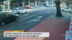 Câmera registra acidente seguido de capotamento