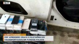 PRF apreende crack e eletrônicos transportados em fundos falsos