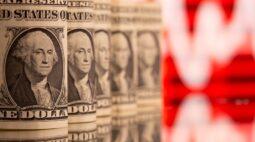 Dólar cai com exterior, mas risco fiscal mantém moeda acima de R$5,70