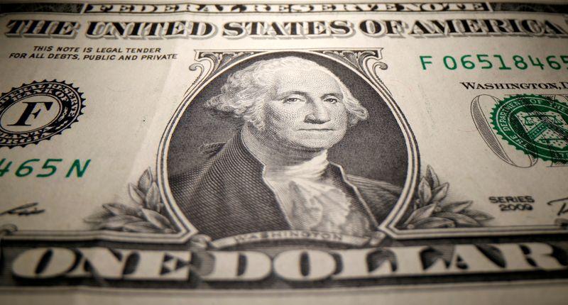 Dólar devolve perdas contra real; mercados digerem dados de inflação dos EUA